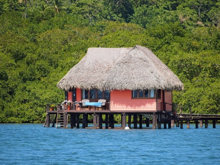 thatched house: Thatched cabin above the sea on the tropical island of Bastimentos, Caribbean sea, Bocas del Toro, Panama