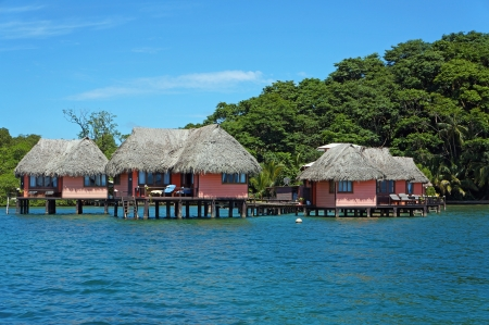 Eco resort with thatched cabins above the sea on the tropical island of Bastimentos, Caribbean sea, Bocas del Toro, Panama