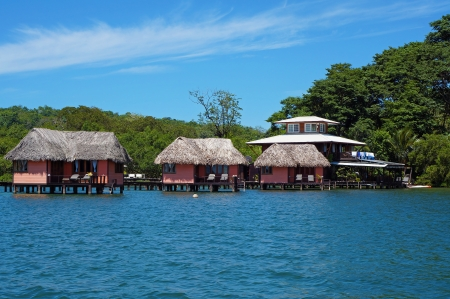 stilt: Eco resort with thatched bungalow over water, island of Bastimentos, Caribbean sea, Bocas del Toro