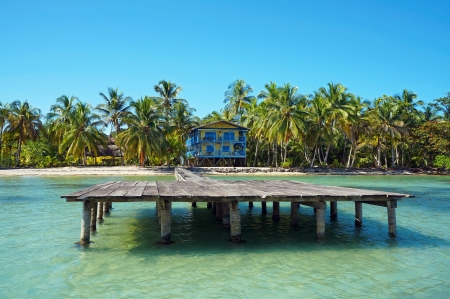Tropical coastline with beach house and its dock, Caribbean sea photo