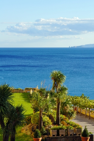 Garden overlooking the Mediterranean sea with Medes islands at the horizon, Rosas, Costa Brava, Catalonia, Spain photo