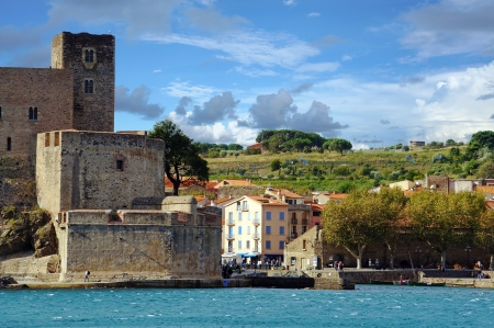 mediterranean coast: Royal castle with cloudy blue sky in the village of Collioure, Mediterranean sea, Vermilion coast, Roussillon, Pyrenees Orientales, France