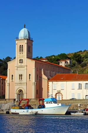 port vendres: Mediterranean church with fishing boat in the harbor of Port-Vendres, Vermilion coast, Roussillon, France