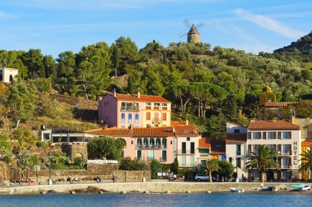 vermilion coast: Mediterranean coast in Collioure village with hotel restaurant and a windmill at the top of the hill, Roussillon, Vermilion coast, Pyrenees Orientales, France