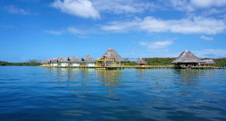 colon panama: Panoramic view over a tropical resort with thatched bungalows over the sea, Colon island, Caribbean sea, Bocas del Toro, Panama Editorial