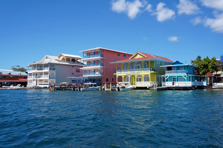 Colorful Caribbean buildings over the water with boats at dock in Colon island, Bocas del Toro, Panama