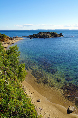 cove: Beautiful beach of the Mediterranean sea with clear waters and a small rocky island,  cala Bonifaci, Rosas, Costa Brava, Catalonia, Spain