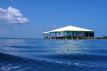 stilt house: From water surface, Caribbean house on stilts over water, Panama, Central America Editorial