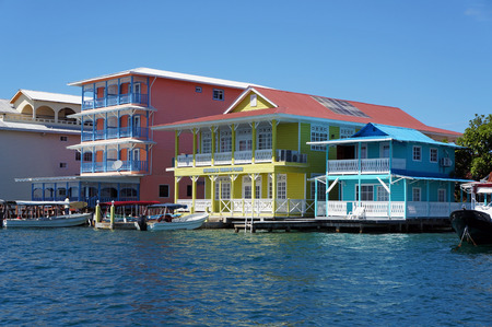 Colorful Caribbean houses over water with boats at dock, Colon island, Bocas del Toro, Panama