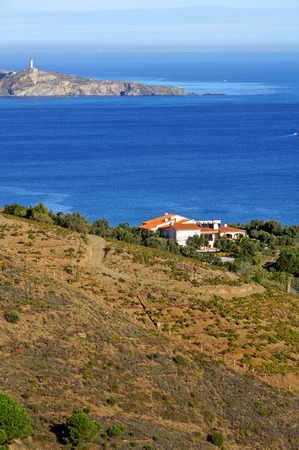 vermilion coast: Villa above the Mediterranean sea with Cap Bear and its lighthouse in background, Roussillon, Vermilion coast, France