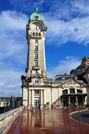 Clock tower of Benedictins train station, city of Limoges, Limousin, France photo
