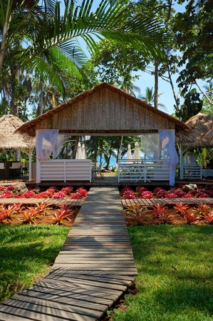 viejo: Walkway to a restaurant in a tropical garden close to the Caribbean sea, Puerto Viejo de Talamanca, Costa Rica Stock Photo
