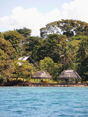 boathouse: Boathouse and palapa on the beach with house in the background