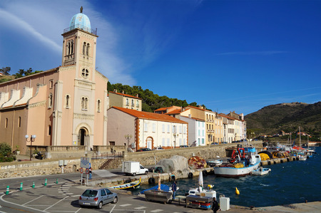 port vendres: Fishing harbor and church of Port Vendres in the Pyrenees Orientales, Mediterranean sea, Roussillon, Cote Vermeille, France Stock Photo