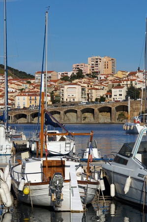vermilion coast: Boats at dock in the marina of Banyuls-sur-Mer with the town in background, French Mediterranean coast, Roussillon, Vermilion coast, France