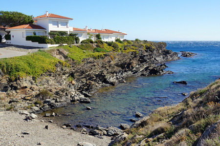Cove with waterfront villa in the coast of the Mediterranean sea, Cadaques, Catalonia, Costa Brava, Spain photo