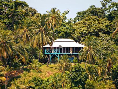 antilles: House on stilts surrounded by lush tropical vegetation, Caribbean, Bocas del Toro, Panama