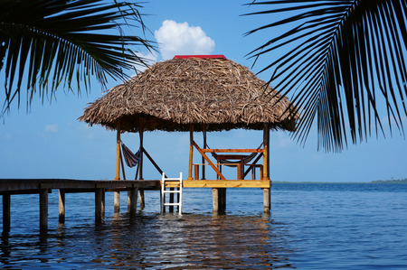 thatched roof: Palapa hut overwater with thatched roof made of dried palm leaves, Caribbean sea Stock Photo