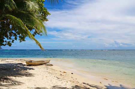 dugout: tropical beach of an Caribbean island with a dugout canoe on the sand, Zapatilla cays, Panama