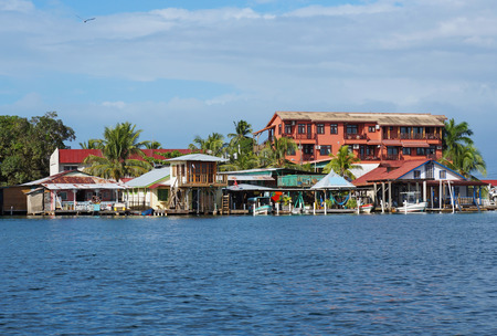 colon panama: houses over water with boats at dock in Bocas town, Colon island, archipelago of Bocas del Toro, Caribbean, Panama