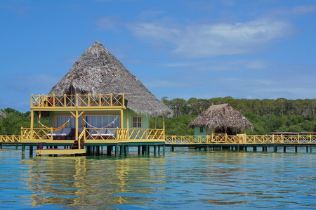 thatched roof: Over water bungalow with thatched roof, Caribbean sea, Bocas del Toro, Central America, Panama