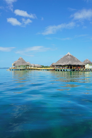 thatched roof: Tropical resort over the sea with thatched roof cabins and restaurant, Caribbean, Central America, Panama