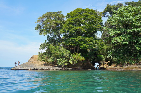 uva: Caribbean shore of Costa Rica with a natural cave in the rock and lush tropical vegetation, Punta uva, Puerto Viejo