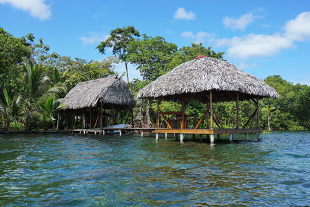 boathouse: Waterfront property with thatched tropical hut and boathouse over the sea, Caribbean, Panama