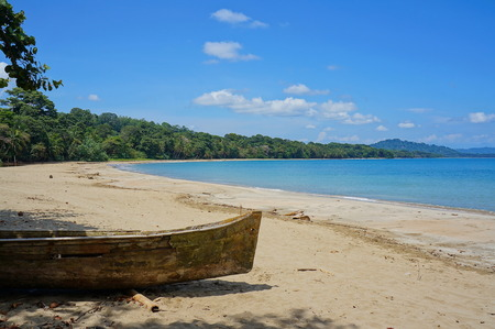 dugout: Pristine beach of Punta Uva with an old dugout canoe in foreground, Caribbean coast of Costa Rica, Puerto Viejo de Talamanca