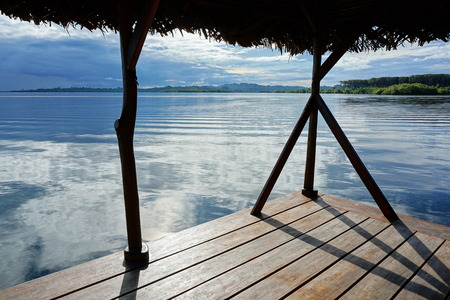 palapa: Peaceful view from a tropical hut over the sea with islands at the horizon, archipelago of Bocas del Toro, Caribbean, Panama
