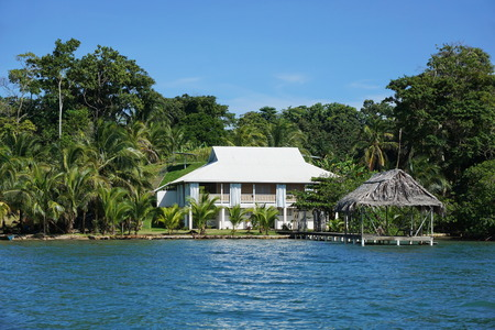 waterfront property: Waterfront property with a Caribbean house and thatched hut over the sea, Bocas del Toro, Panama, Solarte island