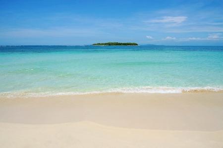 caribbean island: Beach sand with turquoise water and a tropical island at the horizon, Caribbean sea, Bocas del Toro, Cayos Zapatilla, Panama