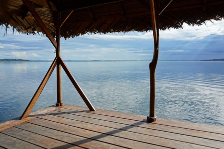 horizon over water: Peaceful seascape from a tropical hut over the water, Bocas del Toro, Caribbean sea, Panama Stock Photo