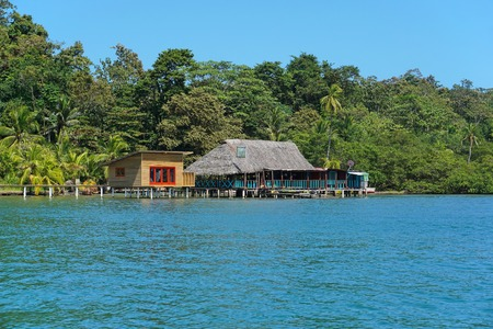 bocas del toro: Tropical restaurant with thatched roof and a cabin over the water, island of Bastimentos, Caribbean, Bocas del Toro, Central America, Panama Editorial