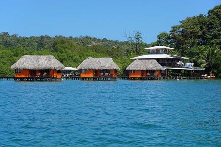 bocas del toro: Caribbean resort with thatched overwater bungalows, Bastimentos island, Bocas del Toro, Panama, Central America