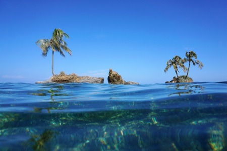 islets: Small islets with coconut tree viewed from sea surface, Zapatillas island, Caribbean, Panama, Central America Stock Photo