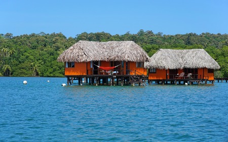 architecture bungalow: Overwater bungalow with thatched roof, Caribbean sea, Bocas del Toro, Panama Editorial