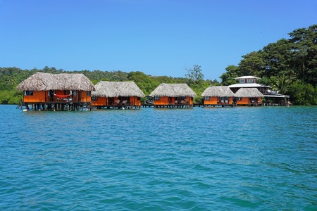 architecture bungalow: Tropical resort over the water with thatched bungalows, Bocas del Toro, Panama, Central America