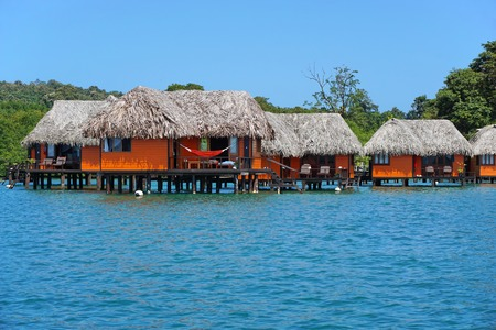 bocas del toro: Overwater bungalows with thatched roof on the Caribbean coast of Panama, Bocas del Toro, Central America Editorial