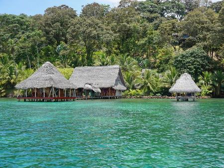 bocas del toro: Lush tropical shore with small eco resort over the Caribbean sea in Panama Bocas del Toro Central America
