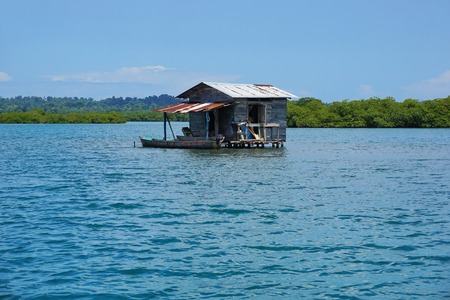 stilts: Secluded rustic hut on stilts over the water in the archipelago of Bocas del Toro Panama Central America