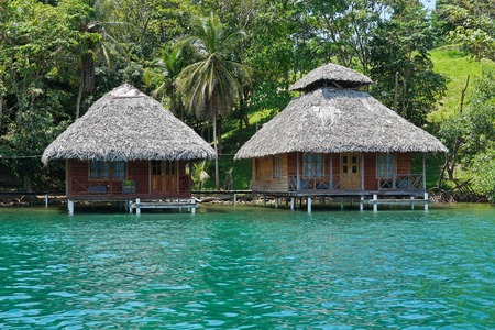 bocas del toro: Tropical wooden bungalows with thatched roof over the water Caribbean sea Bocas del Toro Central America Panama