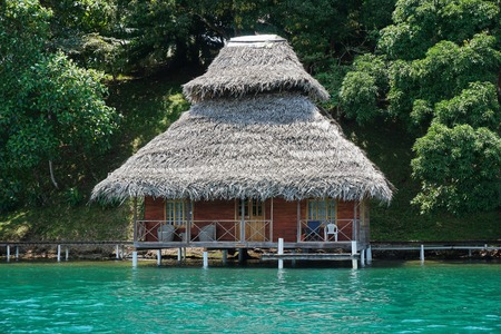 architecture bungalow: Overwater bungalow with thatch roof on the Caribbean coast of Panama Central America