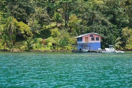 boathouse: Waterfront property on the Caribbean coast of Panama with tropical home overwater, Bocas del Toro, Central America