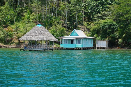 palapa: Typical house with thatched hut over the water in Bocas del Toro, Caribbean coast of Panama, Central America