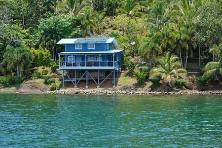 waterfront property: Off grid coastal home with lush tropical vegetation, Caribbean shore of Panama, Bocas del Toro, Central America