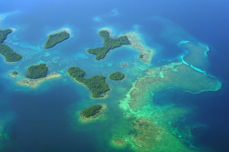 Aerial view of Mangrove islands with shallow coral reefs in the archipelago of Bocas del Toro, Caribbean sea, Panama