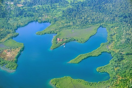 archipelago: Aerial view of a lagoon with a small resort in construction in the archipelago of Bocas del Toro, Cristobal island, Panama, Central America