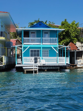stilt house: Typical Caribbean house over the water with small dock, Colon island, Bocas del Toro, Panama, Central America Stock Photo