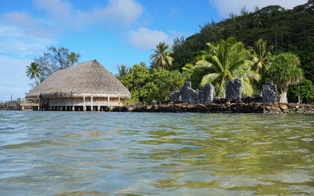 shore: Marae and Fare Potee on the shore of the lake Fauna Nui, Maeva, Huahine island, French Polynesia